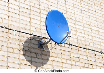 A satelite is attached to the wall
