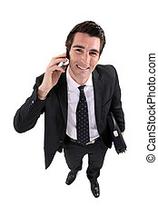 A satisfied businessman over the phone.