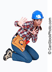A scared female construction worker.