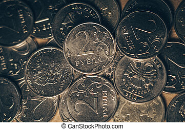 A scattering of Russian coins, with a face value of 2 rubles
