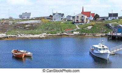 Scene of colorful buildings at Peggys Cove, Nova Scotia - A...