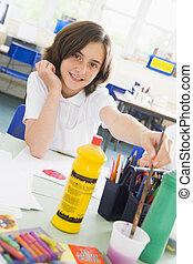 A schoolgirl in an art class