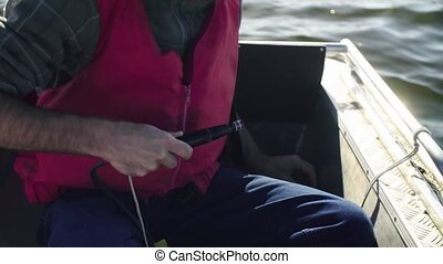 A scientist measuring the pH of the lake using a pH meter -...