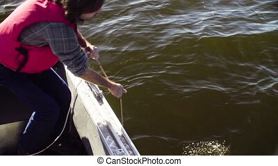 A scientist taking sample of water from lake - Close up...