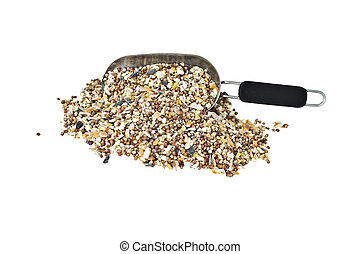 A scoop of wild bird seed isolated on white