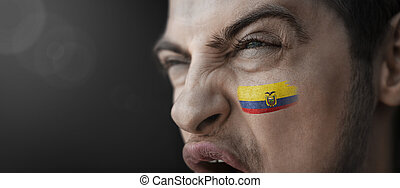 A screaming man with the image of the Ecuador national flag on his face