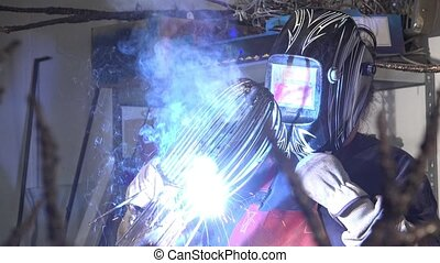 a sculptor arc working on statue - twisting and welding...