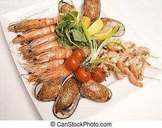 Sea food platter - A Sea food platter with salad on a plate