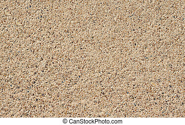 A seamless rough pebble concrete footpath or sidewalk background