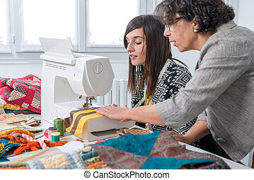 seamstress and her apprentice with sewing machine