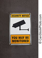 A security surveillance sign