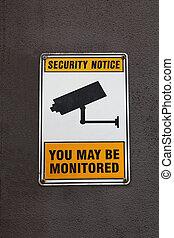 A security surveillance sign