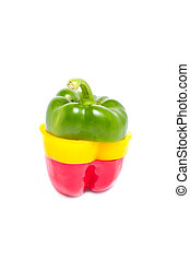 A selection of colorful sweet peppers sliced and combinated in one pepper isolated on white background.