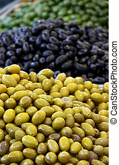 A selection of olives at a market - Green and black olives ...