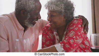 A senior african american couple spending time together at home  social distancing in quarantine.