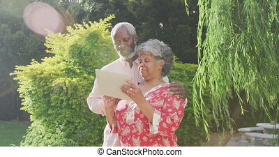 A senior African American couple spending time together in the garden