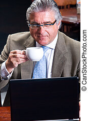senior businessman drinking coffee
