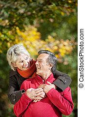 A senior couple enjoying the moment of love