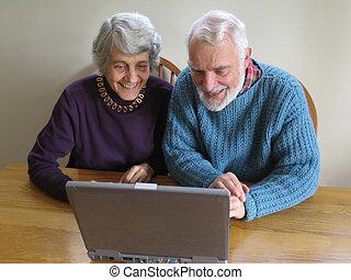 senior couple web surf