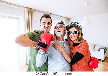 A senior couple with grandson having fun at home.