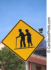 A senior crossing warning sign in Calgary's china town.