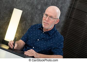 senior designer using graphic tablet at office