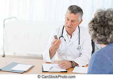 A senior doctor talking with his pa