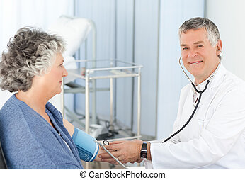 A senior doctor with his patient