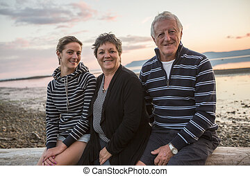 Senior father and mother With Adult Daughter At Sea