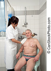 senior is bathed by nurses
