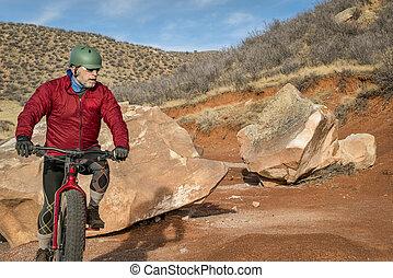 riding a fat bike on mountain desert trail