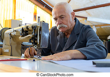 a senior man in factory
