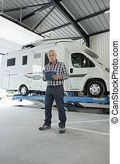 a senior man in garage