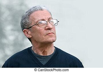 A senior man looking up