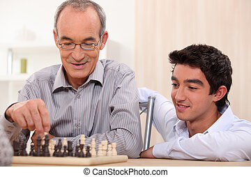 a senior man playing chess