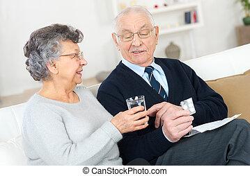 a senior man taking medicaments
