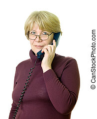 a senior woman at telephone