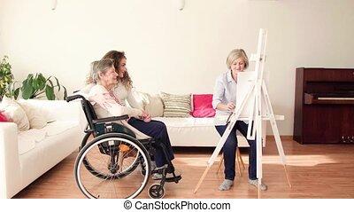 A senior woman drawing at home.
