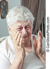 senior woman laughing out loud in living room - A senior...