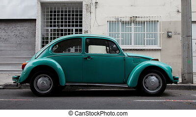 a sequence of 500 volkswagen beetle cars shot from the side...