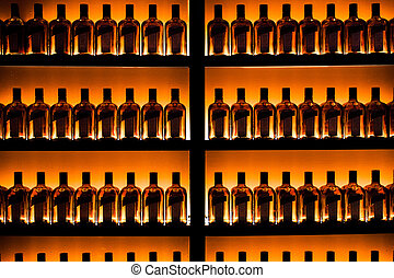 series of bottles against the wall