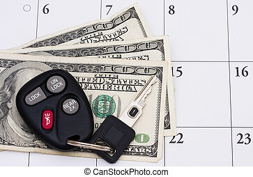 Car Payment is due - A set of car keys with cash on a...