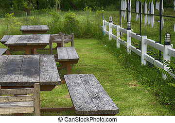 A set of chairs in the garden.
