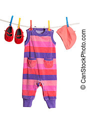 A set of children's clothes hanging on a clothesline.