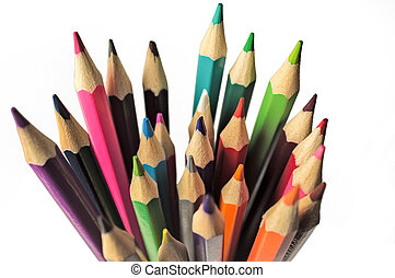 A set of colored pencils in a glass top view closeup on white background