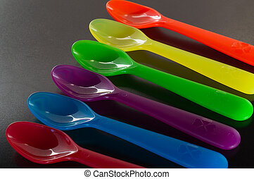 A set of colorful plastic spoons.