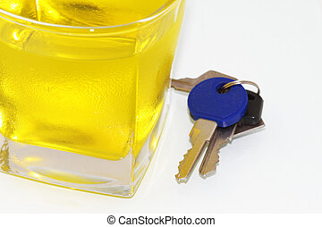keys in front of a wine glass