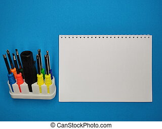 A set of multi-colored screwdrivers on a blue background. Copy space.