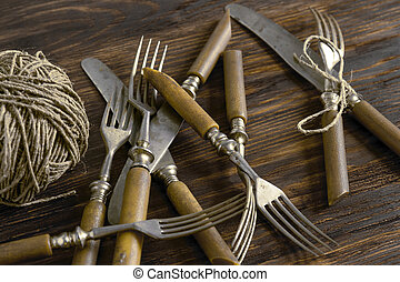A set of old cutlery with a skein of thread