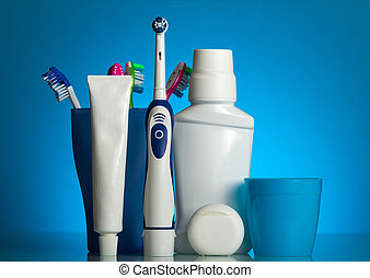 A set of oral care products and various toothbrushes on...